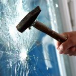 Smashing security glass with hammer